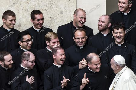YEARENDER 2020  PERSONALITIES  Clergymen laugh as Pope Francis (R) attends the general audience, in San Damaso courtyard, in the Vatican City, 30 September 2020. In October, Pope Francis introduced his new Encyclical.