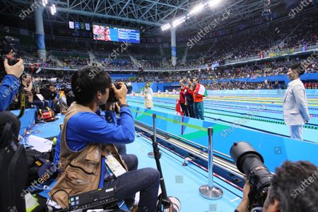 Stock Photo of Photographers, Hilary Caldwell (CAN), Maya Dirado (USA), Katinka Hosszu (HUN) - Swimming : Women's 200m Backstroke Medal Ceremony at Olympic Aquatics Stadium during the Rio 2016 Olympic Games in Rio de Janeiro, Brazil.