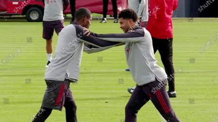 A screenshot from a handout video made available by Bayern Munich of Bayern Munich players David Alaba (L) and Serge Gnabry (R) during a training session in Munich, Germany, 20 October 2020 (issued 21 October 2020). Serge Gnabry has tested positive for COVID-19, as FC Bayern announced on 20 October. Gnabry is in quarantine at home, the announcement said.