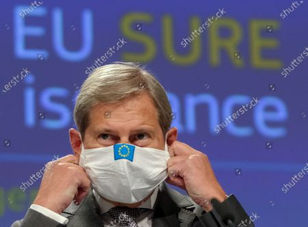 European Commissioner for Budget Johannes Hahn gives a press conference on the first issuance of EU social bonds under the temporary Support to mitigate Unemployment Risks in an Emergency (SURE) at the European Commission in Brussels, Belgium, 21 October 2020.