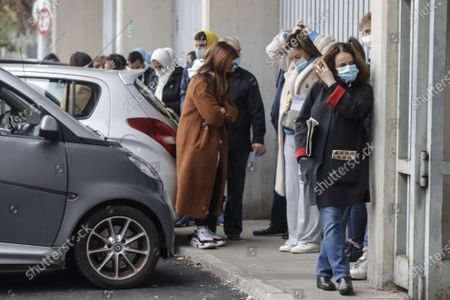 People line up to get tested for COVID-19 at the San Carlo Borromeo hospital, in Milan, Italy