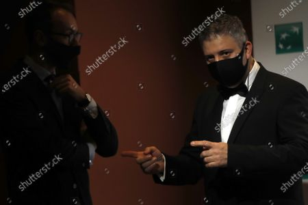 "Director Evgeny Afineevsky wears a mask to curb the spread of COVID-19 as he arrives for the photo call for the movie ""Francesco"" at the Rome Film Festival, in Rome"
