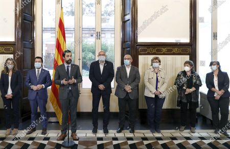 Catalonian Parliament speaker Roger Torrent (3nd-L), Catalan regional Deputy President, acting President and leader of Catalan pro-independent ERC party Pere Aragones (2nd-L) and Presidential regional minister Meritxell Budo (L) welcome former Catalonia's MPs Lluis Corominas (4th-L) , Lluis Guino (4th-R), Anna Simo (3rd-R), Ramona Barrufet (2nd-R) and Mireia Boya (R), all of them condemned for disobedience, prior to their meeting in Aragone's office at the chamber in Barcelona, Catalonia, north-eastern Spain, 21 October 2020. Aragones claimed on 21 October the freedom of the pro-independence prisoners.