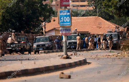 Security forces prevent demonstrators from reaching the Sudanese army headquarters, in Khartoum, Sudan, . Protesters have taken to the streets in the capital and across the country over dire living conditions and a deadly crackdown on demonstrators in the east earlier this month. Sudan is currently ruled by a joint civilian-military government, following the popular uprising that toppled longtime autocrat Omar al-Bashir last year