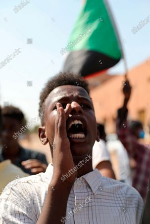 Man shouts at a demonstration, in Khartoum, Sudan, . Protesters have taken to the streets in the capital and across the country over dire living conditions and a deadly crackdown on demonstrators in the east earlier this month. Sudan is currently ruled by a joint civilian-military government, following the popular uprising that toppled longtime autocrat Omar al-Bashir last year