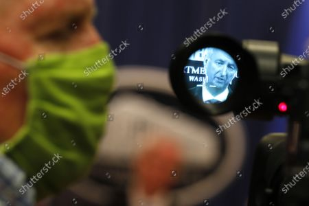 Deputy US Attorney General Jeffrey Rosen is seen through TV viewfinder as he speaks at a news conference to announce the results of the global resolution of criminal and civil investigations with an opioid manufacturer at the Justice Department in Washington, DC, USA, 21 October 2020.