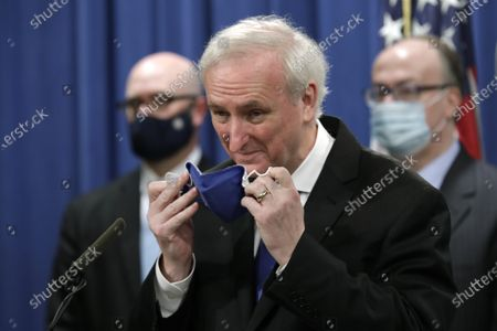 Deputy US Attorney General Jeffrey Rosen removes his face mask as he speaks at a news conference to announce the results of the global resolution of criminal and civil investigations with an opioid manufacturer at the Justice Department in Washington, DC, USA, 21 October 2020.