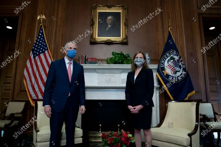 WASHINGTON, DC - OCTOBER 21: Supreme Court nominee Judge Amy Coney Barrett meets with U.S. Sen. Rob Portman (R-OH) at the U.S. Capitol in Washington, DC. President Donald Trump nominated Barrett to replace Justice Ruth Bader Ginsburg after her death. (Photo by Stefani Reynolds/Getty Images)