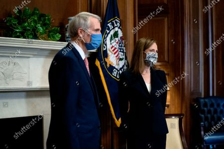 United States Supreme Court nominee Judge Amy Coney Barrett (R) meets with United States Senator Rob Portman (Republican of Ohio) at the U.S. Capitol in Washington, DC. President Donald Trump nominated Barrett to replace Justice Ruth Bader Ginsburg after her death.