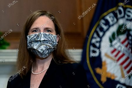 United States Supreme Court nominee Judge Amy Coney Barrett wears a protective mask as she meets with United States Senator Rob Portman (Republican of Ohio), not pictured, at the U.S. Capitol in Washington, DC. President Donald Trump nominated Barrett to replace Justice Ruth Bader Ginsburg after her death.