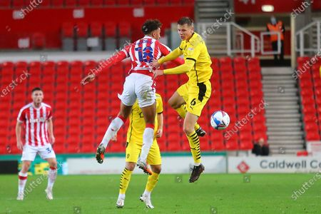 Stock Image of Barnsley defender Mads Juel Andersen (6) and Stoke City forward Mame Biram Diouf (18) during the EFL Sky Bet Championship match between Stoke City and Barnsley at the Bet365 Stadium, Stoke-on-Trent