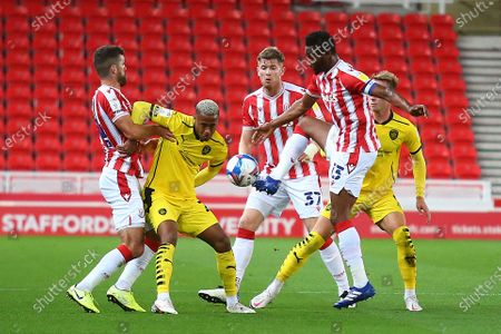 Stoke City's John Obi Mikel (13) takes control during the EFL Sky Bet Championship match between Stoke City and Barnsley at the Bet365 Stadium, Stoke-on-Trent