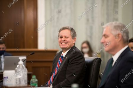 Stock Photo of United States Senator Steve Daines (Republican of Montana), left, is joined by Amtrak President and Chief Executive Officer William Flynn, right, during the first panel of a Senate Committee on Commerce, Science, and Transportation hearing to examine passenger and freight rail, focusing on the current status of the rail network and the track ahead, in the Russell Senate Office Building on Capitol Hill in Washington, DC,.