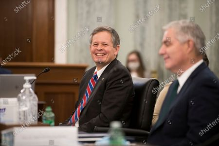 United States Senator Steve Daines (Republican of Montana), left, is joined by Amtrak President and Chief Executive Officer William Flynn, right, during the first panel of a Senate Committee on Commerce, Science, and Transportation hearing to examine passenger and freight rail, focusing on the current status of the rail network and the track ahead, in the Russell Senate Office Building on Capitol Hill in Washington, DC,.