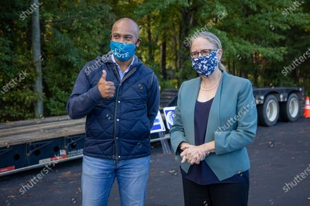 Former Massachusetts Governor Deval Patrick poses with Democratic congressional candidate Carolyn Bourdeaux (GA-07) for a photo at a get out the vote event for at an early voting location in Lawrenceville, GA