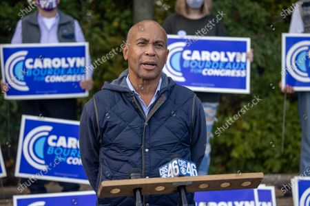 Former Massachusetts Governor Deval Patrick talks to the press while at a get out the vote event for Democratic congressional candidate Bourdeaux (GA-07) at an early voting location in Lawrenceville, Georgia on October 21st.