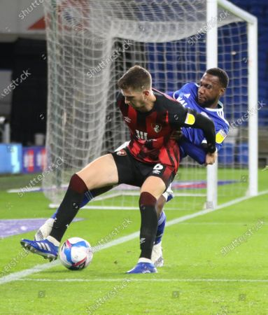 Junior Hoilett of Cardiff City and Chris Mepham of Bournemouth compete for the ball