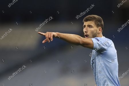 Manchester City's Ruben Dias gives instructions during the Champions League group C soccer match between Manchester City and FC Porto at the Etihad stadium in Manchester, England