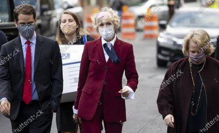 Stock Image of E. Jean Carroll (C) arrives to Federal District Court to attend a hearing where her attorneys and attorneys for the US Justice Department are arguing about a motion to have the US substituted as the defendant in Carroll's defamation suit against US President Donald J. Trump in New York, New York, USA, 21 October 2020. Carroll, who has accused Trump of raping her in a dressing room in the 1990s, has sued Trump for a number of allegedly defamatory statements he made after the release of her book in 2019.