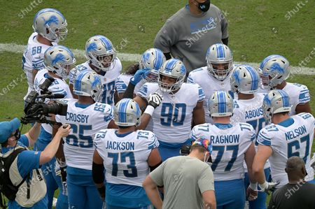 Detroit Lions defensive end Trey Flowers (90) leads a huddle on the field before an NFL football game against the Jacksonville Jaguars, in Jacksonville, Fla