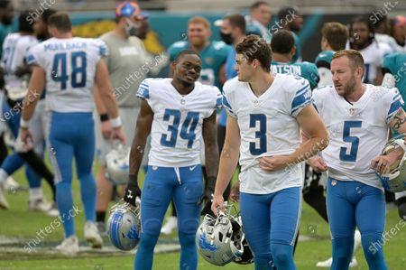 Detroit Lions cornerback Tony McRae (34), punter Jack Fox (3) and kicker Matt Prater (5) walk off the field after an NFL football game against the Jacksonville Jaguars, in Jacksonville, Fla