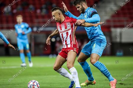 Stock Photo of Olympiacos' Rafinha (L) vies for the ball with Marseille's Duje Caleta-Car during the UEFA Champions League  soccer match between Olympiacos Piraeus and Olympique Marseille held at Georgios Karaiskakis Stadium in Piraeus, Greece, 21 October 2020.