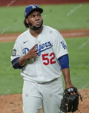 Stock Photo of Arlington, Texas, Tuesday, October 20, 2020 Los Angeles Dodgers relief pitcher Pedro Baez (52) tapas his chest after holding the Rays scoreless in the eighth inning in game one of the World Series at Globe Life Field. (Robert Gauthier/ Los Angeles Times)