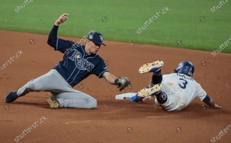Arlington, Texas, Tuesday, October 20, 2020 Los Angeles Dodgers second baseman Chris Taylor (3) beats the tag of Tampa Bay Rays second baseman Brandon Lowe (8) on a wild pitch in the fourth inning in game one of the World Series at Globe Life Field. (Robert Gauthier/ Los Angeles Times)