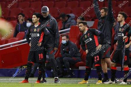 (L-R) Liverpool's player Takumino Minamino, head coach Jurgen Klopp, players Xherdan Shaqiri and Diogo Jota during the UEFA Champions League group stage match between Ajax Amsterdam and Liverpool FC at Johan Cruijff Arena in Amsterdam, the Netherlands, 21 October 2020.