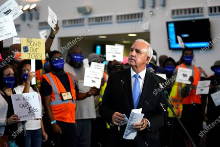 Miami-Dade County Mayor Carlos Gimenez speaks during a protest by workers in the cruise ship industry wanting to return to work, at PortMiami, in Miami. The Centers for Disease Control and Prevention (CDC) issued a No Sail Order for cruise ships through Oct. 31 during the coronavirus pandemic
