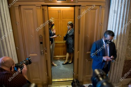 Stock Image of United States Senator Susan Collins (Republican of Maine) and a staff member board an elevator following a vote at the US Capitol in Washington, DC,.