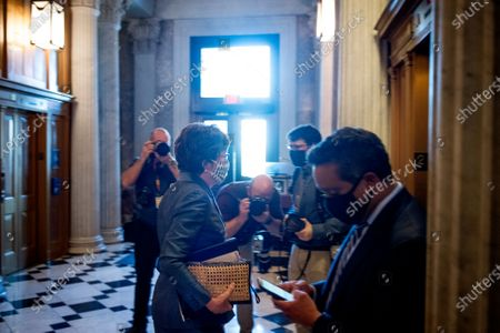 Stock Photo of United States Senator Susan Collins (Republican of Maine) makes her way to an elevator following a vote at the US Capitol in Washington, DC,.