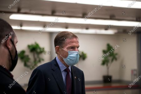 United States Senator Richard Blumenthal (Democrat of Connecticut) talks with reporters while waiting for a train in the Senate subway following a vote at the US Capitol in Washington, DC,.
