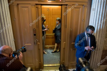 United States Senator Susan Collins (Republican of Maine) and a staff member board an elevator following a vote at the US Capitol in Washington, DC,.