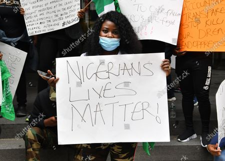 A demonstrator protests the recent violence in Nigeria on the streets of Manhattan