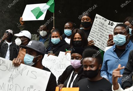 Demonstrators protest the recent violence in Nigeria on the streets of Manhattan