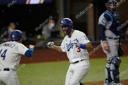 Los Angeles Dodgers' Chris Taylor celebrates a two-run home run with Enrique Hernandez against the Tampa Bay Rays during the fifth inning in Game 2 of the baseball World Series, in Arlington, Texas