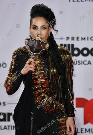Ivy Queen arrives at the Billboard Latin Music Awards, at the BB&T Center in Sunrise, Fla