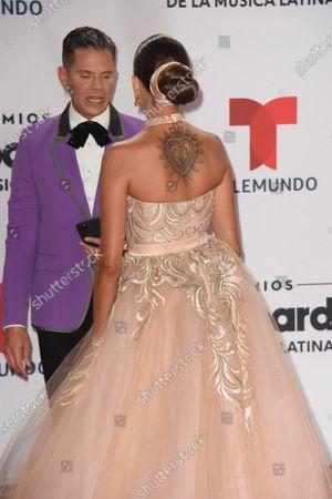 Rodner Figueroa, left, and Natalia Jimenez arrives at the Billboard Latin Music Awards