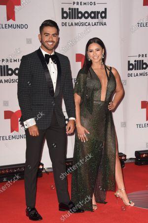 Carlos Adyan, left, and Ana Jurka arrive at the Billboard Latin Music Awards