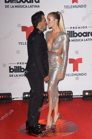 Luis Fonsi, left, and Agueda Lopez arrive at the Billboard Latin Music Awards