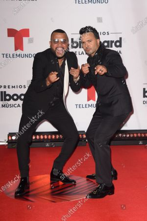 Dimelo Flow, left and Luis Fonsi arrive at the Billboard Latin Music Awards