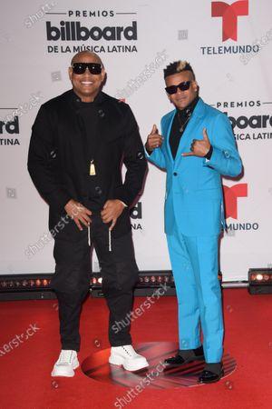Stock Picture of Alexander Delgado, left, and Randy Malcom of Gente de Zona arrive at the Billboard Latin Music Awards