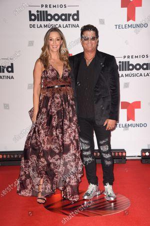 Claudia Elena Vasquez, left, and Carlos Vives arrive at the Billboard Latin Music Awards