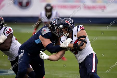 Houston Texans defensive end J.J. Watt (99) rushes against Tennessee Titans offensive tackle Dennis Kelly (71) during the first half of an NFL football game, in Nashville, Tenn