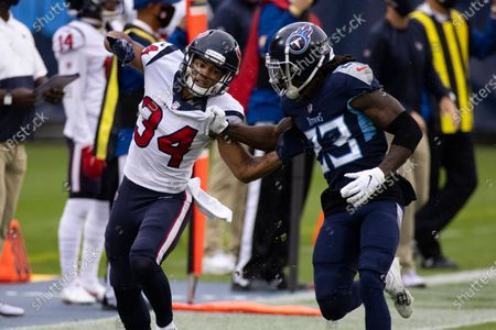 Stock Picture of Houston Texans cornerback John Reid (34) battles with Tennessee Titans cornerback Tye Smith (23) on a punt play during the first half of an NFL football game, in Nashville, Tenn