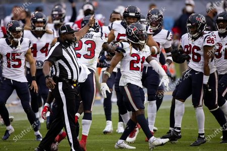 Houston Texans cornerback Bradley Roby (21) celebrates an interception against the Tennessee Titans during the second half of an NFL football game, in Nashville, Tenn
