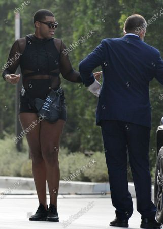 Exclusive - EJ Johnson seen wearing a black fishnet outfit and Dior bag while out and about in Century City