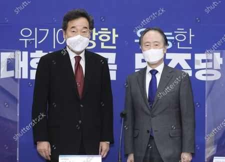 Lee Nak-yon (L), chief of the ruling Democratic Party, poses for a photo with Japanese Ambassador to South Korea Koji Tomita (R) during their meeting at the National Assembly in Seoul, South Korea, 22 October 2020.