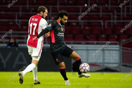 Daley Blind of Ajax duels Mohamed Salah of Liverpool during UEFA Champions league match Ajax-Liverpool on Oktober, 21 2020 in Amsterdam Netherlands
